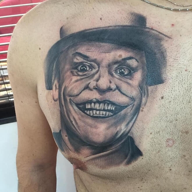 Joker smile tattoo