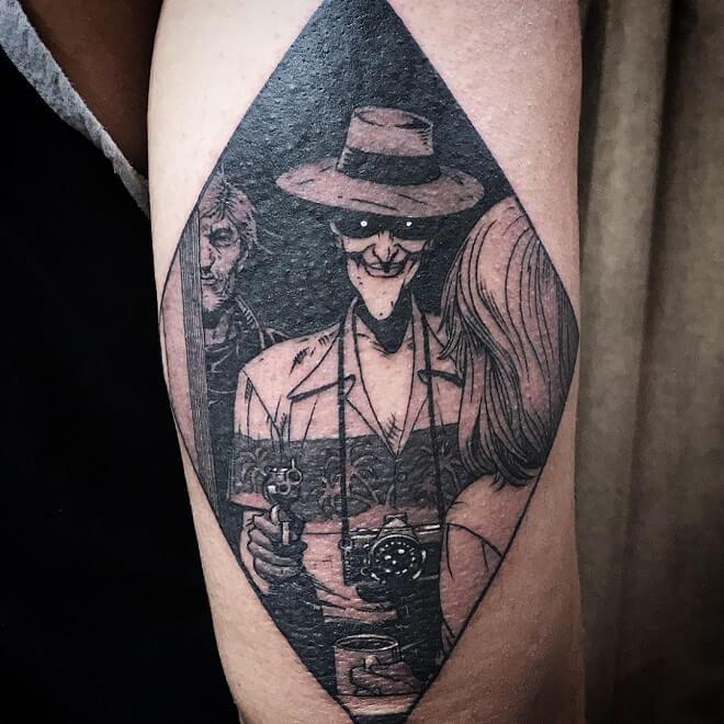 Joker with gun tattoo