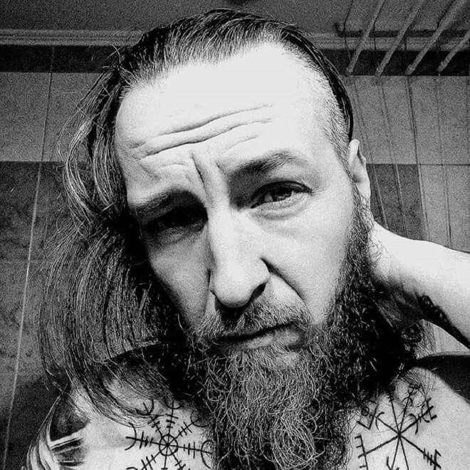 Long hair with small beard