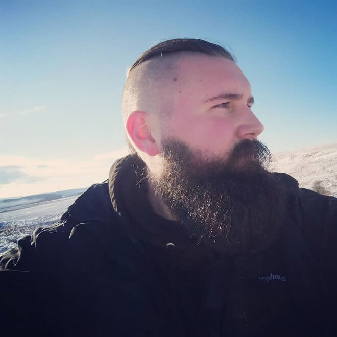 Side part hairstyle with beard
