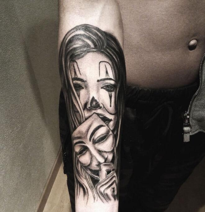 Joker with girl tattoo