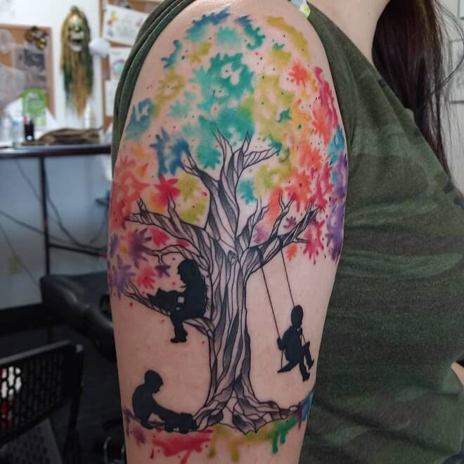 Tree With Children Tattoo On Shoulder