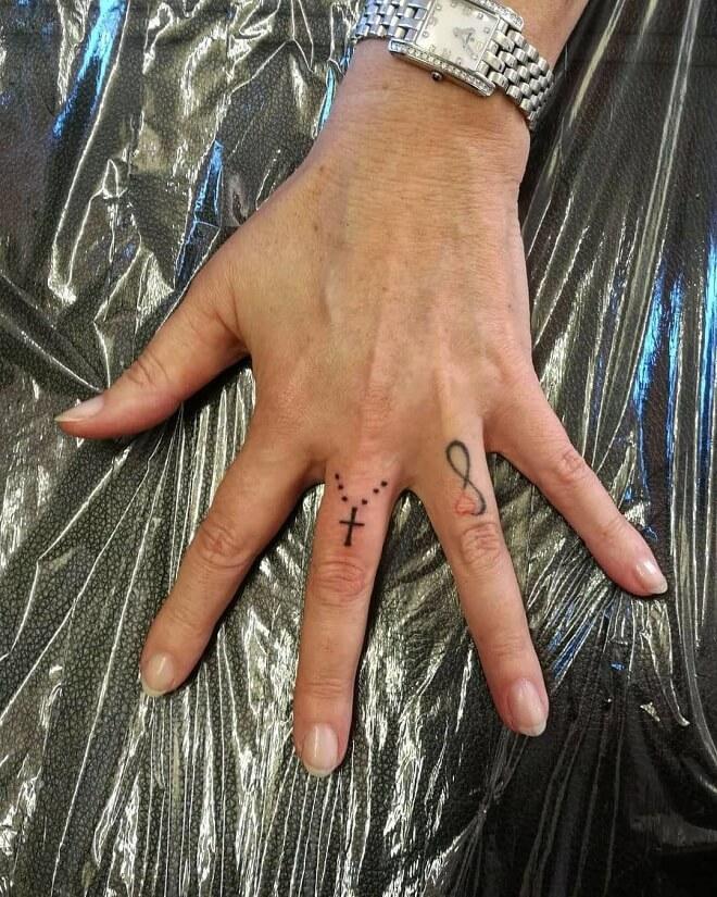 Cross Finger Tattoos