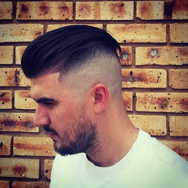 High Skin Fade with Slick Comb Over