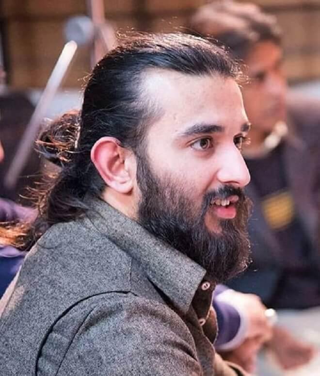 Man Half Bun With Beard Style