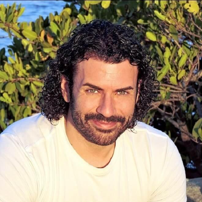 Mid-Length Curly Hair with Stubble Beard