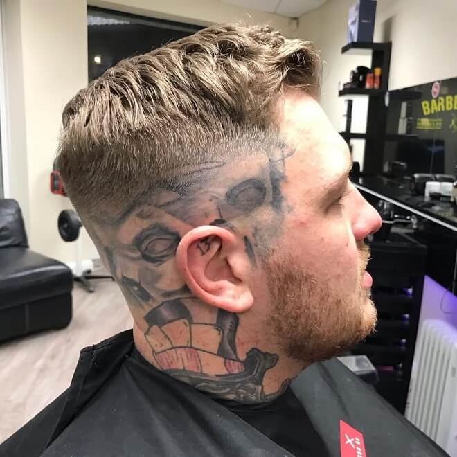 Short Haircut with Low Bald Fade
