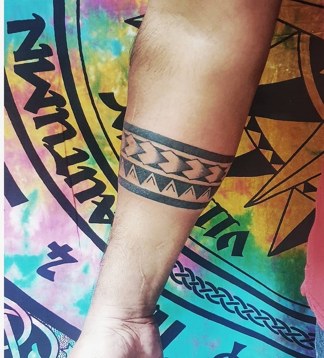 Forearm Tattoo with Tribal Design