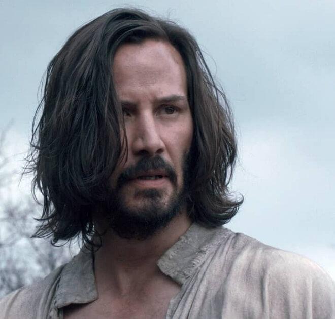 Keanu Reeves Long Side Swept Hairstyle