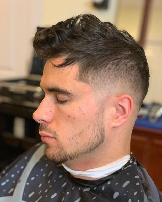 Low Fade with Messy Wavy Hairstyle