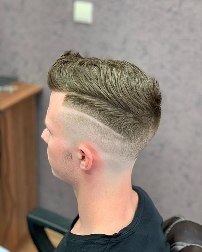 Low Skin Fade with Textured Hair On Top