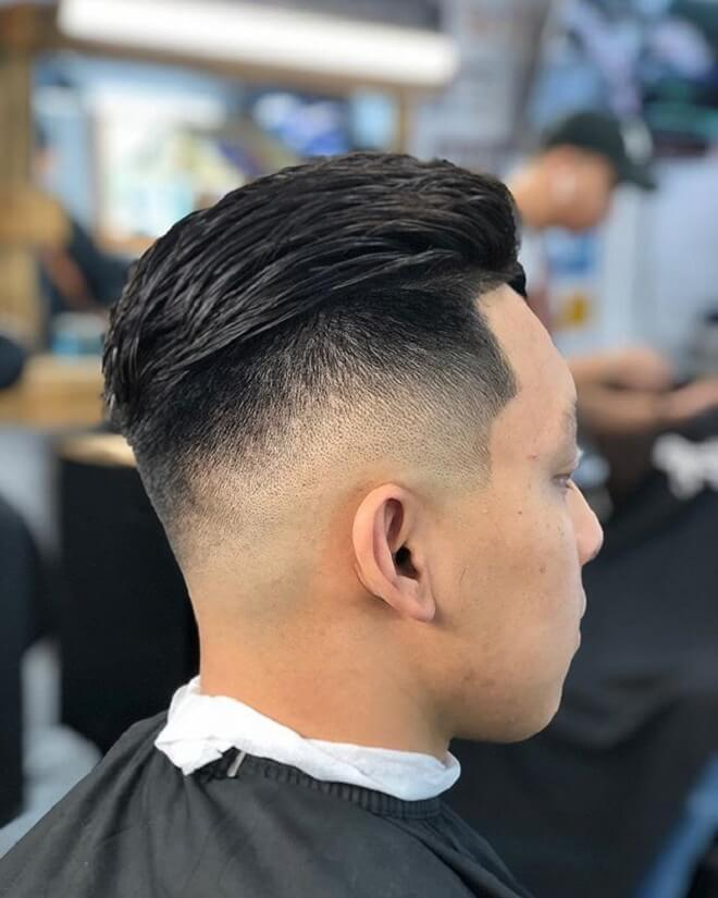 Slicked Back Hair with Low Skin Fade